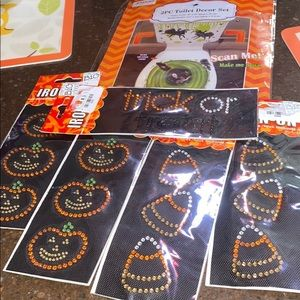 A Halloween toilet decor set and 5 iron on decals